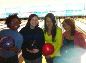 4 girls getting ready to  bowl