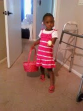 a little girl with an Easter egg in her hand in a pink dress