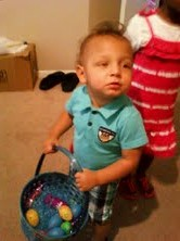 a little boy in blue with his Easter basket