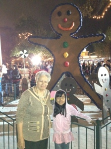 A woman and child in front of a ginger bread man
