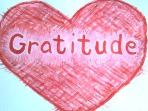 a red heart with the word gratitude