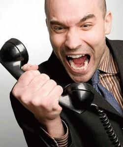 man yelling at a phone