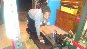 Me doing some weight training at my friends house (Thanks Tricia)